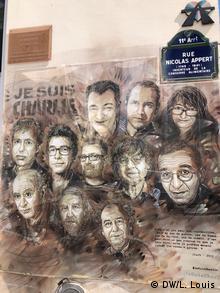 Grafiti sa likovima ubijenih saradnika časopisa Šarli Ebdo