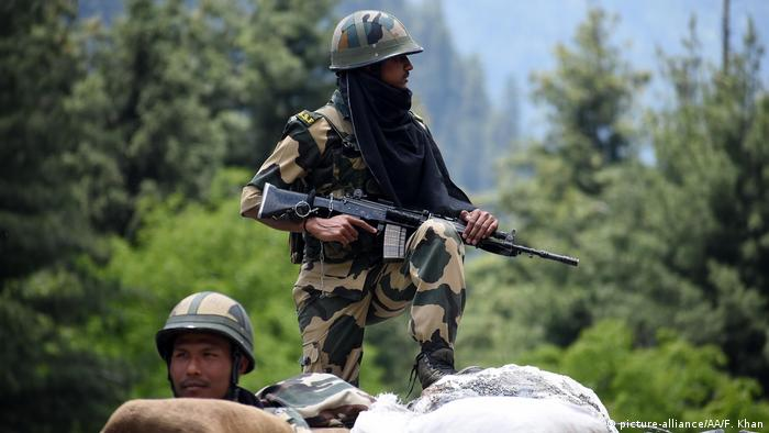 An Indian border security force soldier keeping vigil from a bunker along the Srinagar-Leh National highway on June 17, 2020.