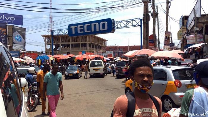 Street scene of people not wearing masks in Accra, Ghana