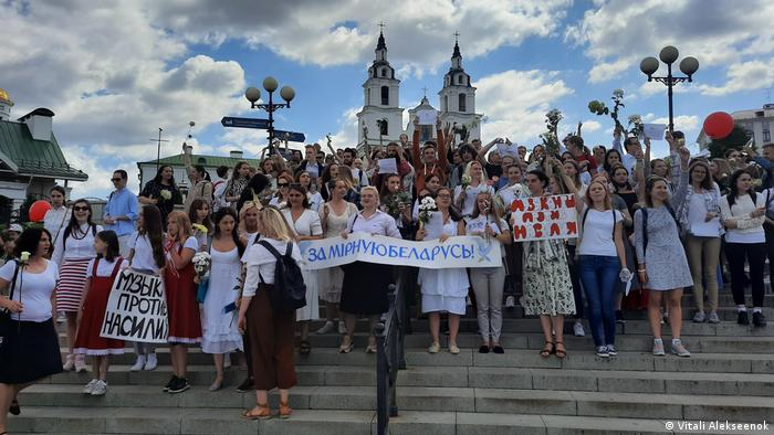 Protesters on stairs with banners in Cyrillic reading Music against violence