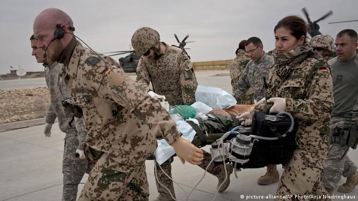 Bundeswehr soldiers transporting a wounded German soldier in Afghanistan