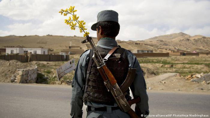 Soldier with flower in his rifle in Afghanistan
