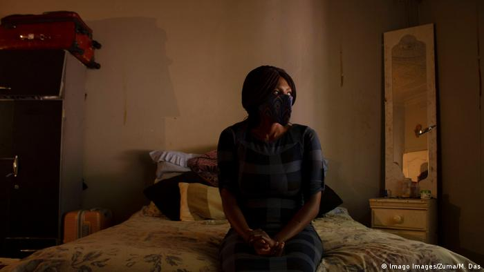 A female sex worker sits on a bed in Johannesburg