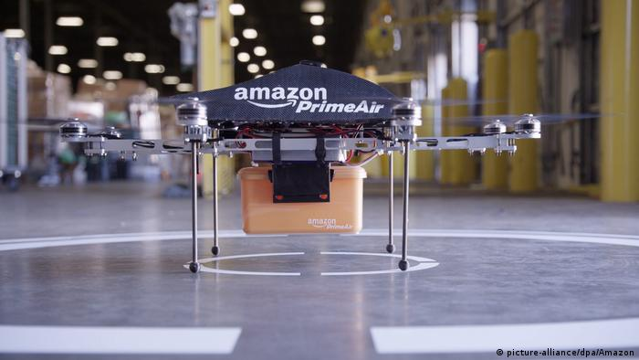 A handout image made available by Amazon in 2013, showing an octocopter drone with an Amazon logo on it, and a box attached underneath