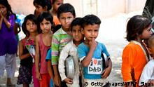 Children from a slum stand in queue to get free food after the government eased a nationwide lockdown as a preventive measure against the COVID-19 coronavirus, in New Delhi on June 15, 2020. (Photo by Prakash SINGH / AFP) (Photo by PRAKASH SINGH/AFP via Getty Images)