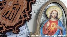 Kuran and bible with Allah monogram and Jesus sacred heart. Interreligious symbole. Vung Tau. Vietnam. | Verwendung weltweit