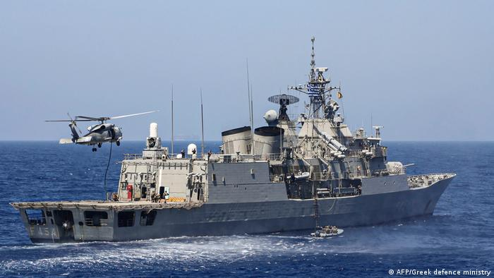 Greek Hydra-class frigate Psara (F-454) of the Hellenic Navy and a military helicopter taking part in a military exercise in the eastern Mediterranean Sea, on August 25, 2020