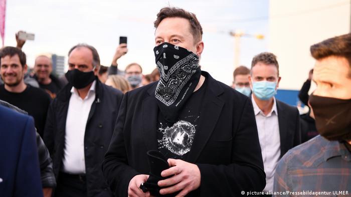 Tesla's Elon Musk wearing a mask while visiting a technology park in Tübingen, Germany