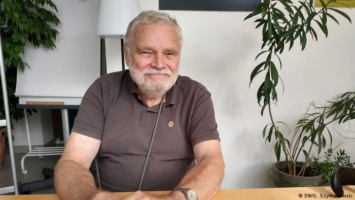 Michael Schwee-de Bailly sitting at a desk in the Grünheide neigborhood center