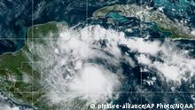 This satellite image released by the National Oceanic and Atmospheric Administration (NOAA) shows Tropical Storm Nana approaching Belize, Wednesday, Sept. 2, 2020. The storm is expected to strengthen throughout the day and make landfall in Belize as a hurricane late Wednesday or early Thursday. (NOAA via AP) |