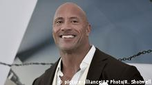 FILE - Dwayne Johnson attends the premiere of Fast & Furious Presents: Hobbs & Shaw on July 13, 2019, in Los Angeles. Johnson said he has acquired the XFL. The 48-year-old actor made the announcement on Twitter. Reportedly the price is $15 million. The XFL had eight franchises and played five games out of a planned 10-game schedule before canceling the remainder of its season in March because of the COVID-19 pandemic.(Photo by Richard Shotwell/Invision/AP, File) |