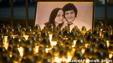 FILE - In this Wednesday, Feb. 28, 2018 file photo, light tributes are seen during a silent protest in memory of murdered journalist Jan Kuciak and his girlfriend Martina Kusnirova, seen in photo, in Bratislava, Slovakia. A court in Slovakia is expected to issue a verdict on Thursday Sept. 3, 2020, in the slayings of an investigative journalist and his fiancee, a crime that shocked the country and led a government to fall. (AP Photo/Bundas Engler, file) |