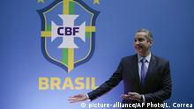 Rogerio Caboclo poses for a picture after being sworn-in as president of the Brazilian Football Confederation in Rio de Janeiro, Brazil, Tuesday, April 9, 2019. The biggest challenges for Caboclo will be ending Brazil's World Cup title drought, dating back to 2002, improving the country's youth teams and moving the national governing body away from scandal. (AP Photo/Leo Correa) |