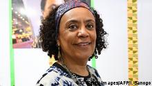 19.03.2019 Multiple Literary Prize French-Ivorian writer Veronique Tadjo poses during a book signing at the 11th Abidjan Book Fair on May 19, 2019 at the Palais de la Culture in Abidjan. - From the Rwandan genocide to the Ebola epidemic and the return of the diaspora to the African continent, the French-Ivorian writer Véronique Tadjo has established herself in the literary landscape by capturing the major issues of her time. (Photo by ISSOUF SANOGO / AFP) (Photo credit should read ISSOUF SANOGO/AFP via Getty Images)