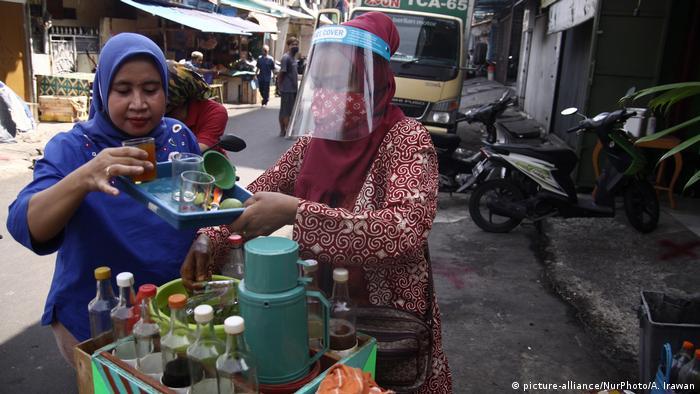 Women selling jamu at stall in Jakarta