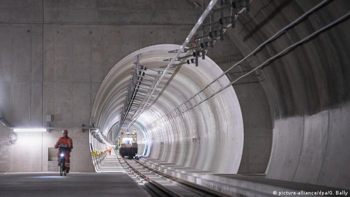 A worker rides a bike through the Ceneri Base Tunnel in 2019