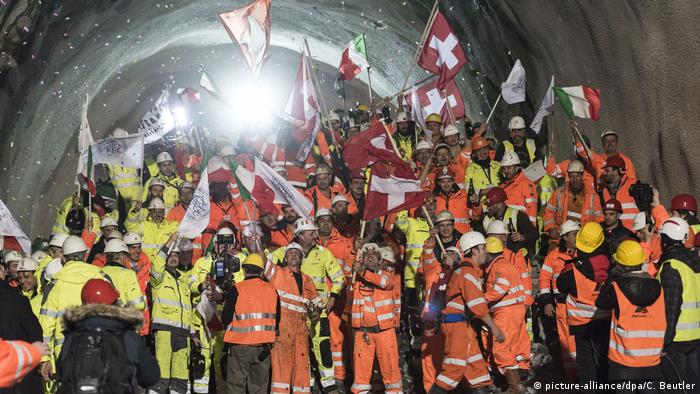 Workers celebrate the final explosives work on the Cereni Base Tunnel in 2016