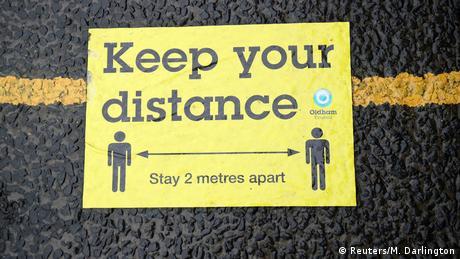 Sign reading keep your distance (Reuters/M. Darlington)