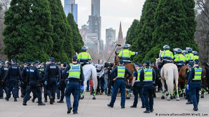 Police patrol the Shrine of Remembrance with the city of Melbourne skyline