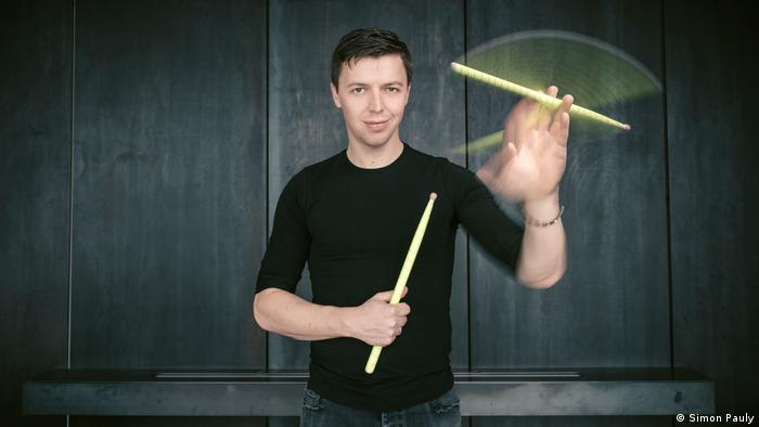 Grubinger whirls a drumstick