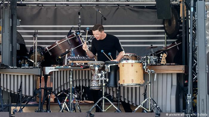 Grubinger performs, backdropped by a huge drume and a xylophone