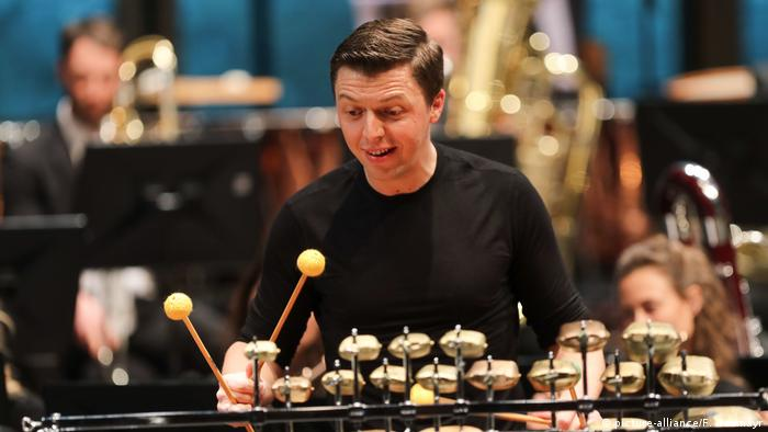 Grubinger with mallots plays an unfamiliar xylophone-like instrument