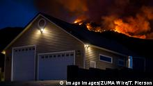 September 5, 2020, Yucaipa, California, USA: Flames from the El Dorado Fire burn a top a hill above a home on Jefferson Street near Ive Avenue in Yucaipa. Yucaipa USA - ZUMAo44_ 20200905_zan_o44_108 Copyright: xTerryxPiersonx