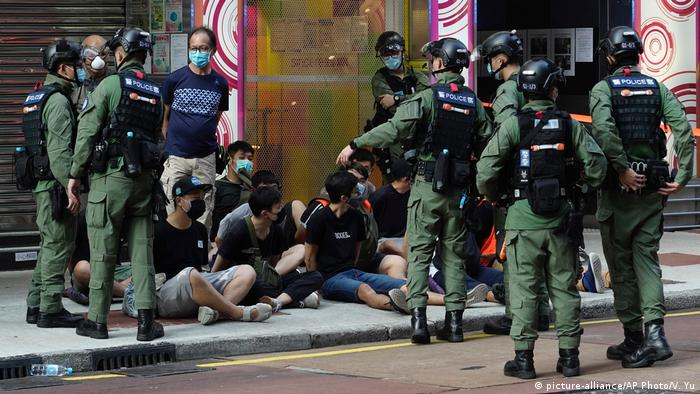 Hong Kong police arrest protesters marching against the government's decision to postpone elections