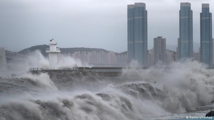Waves crash over a seawall in South Korea during a typhoon