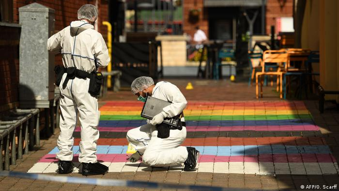 Police collect evidence near Birmingham's Gay Village (AFP/O. Scarff)