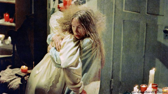 Film still from 'Carrie' with Piper Laurie and Sissy Spacek hugging in a room filled with lit candles (Imago Images/Everett Collection)