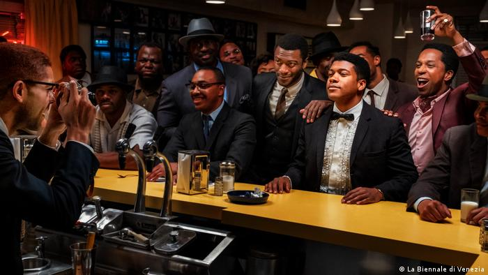 A scene from 'One Night in Miami': Actors portraying Malcolm X, Cassius Clay, Jim Brown and Sam Cooke at a bar
