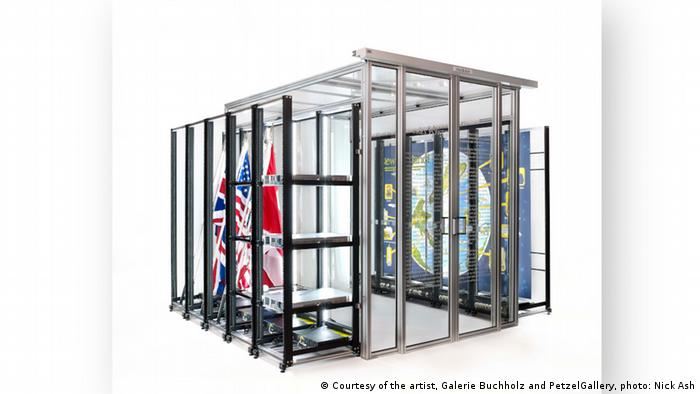 Simon Denny, Modded Server-Rack Display with David Darchicourt Commissioned Map of Aotearoa New Zealand: a cage with flags and a map. (Courtesy of the artist, Galerie Buchholz and PetzelGallery, photo: Nick Ash)