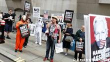 Supporters of WikiLeaks founder Julian Assange are seen outside the Old Bailey, the Central Criminal Court during a hearing to decide whether Assange should be extradited to the United States, in London, Britain September 7, 2020. REUTERS/Peter Nicholls