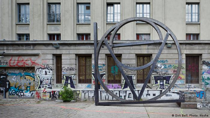 A metal sculpture by Dirk Bell in front of Berghain