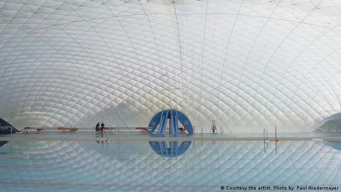 A film still from Shirin Sabahi's video 'Lung' showing the interior of a swimming pool
