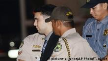 FILE - In this Dec. 1, 2015, file photo, convicted U.S. Marine Lance Cpl. Joseph Scott Pemberton is escorted to his detention cell upon arrival at Camp Aguinaldo at suburban Quezon city, northeast of Manila, Philippines. The Philippine president pardoned the U.S. Marine on Monday, Sept. 7, 2020 in a surprise move that will free him from imprisonment in the 2014 killing of a transgender Filipino woman that sparked anger in the former American colony. (Ted Aljibe/Pool Photo, File) |
