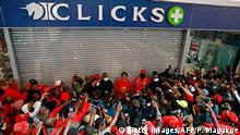 Economic Freedom Fighters (EFF) leader Julius Malema (C) addresses his supporters during a picket outside Clicks Store, a retail-led food and healthcare group which is listed on the Johannesburg Stock Exchange (JSE), at the Mall of the North in Polokwane, on September 7, 2020. - Dozens of South Africa's radical EFF party activists picketed outside stores of a leading retail pharmacy Clicks over a hair advert on its website which described black hair as dull and white hair as normal. The party deemed the adverts racist and demand the pharmacy shuts its shops for five days. (Photo by Phill Magakoe / AFP) (Photo by PHILL MAGAKOE/AFP via Getty Images)