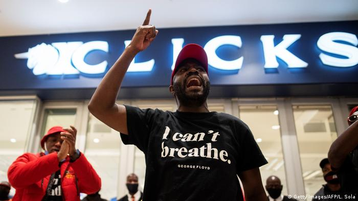 An Economic Freedom Fighters (EFF) supporter gestures during a picket outside the Clicks store in Sandton, South Africa, on September 7, 2020.