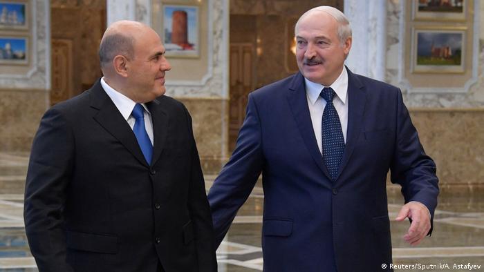 Belarus Minsk | Russlands Ministerpräsident Michail Mischustin und Präsident Alexander Lukashenko (Reuters/Sputnik/A. Astafyev)