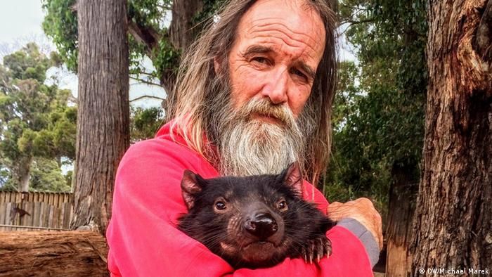 Androo Kelly holding a Tasmanian devil