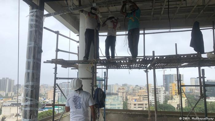 Construction workers at a Wadhwa Group site