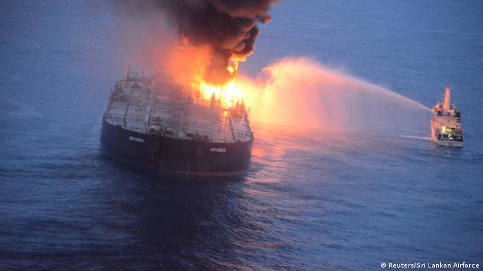 A Sri Lankan navy boat sprays water on the New Diamond supertanker