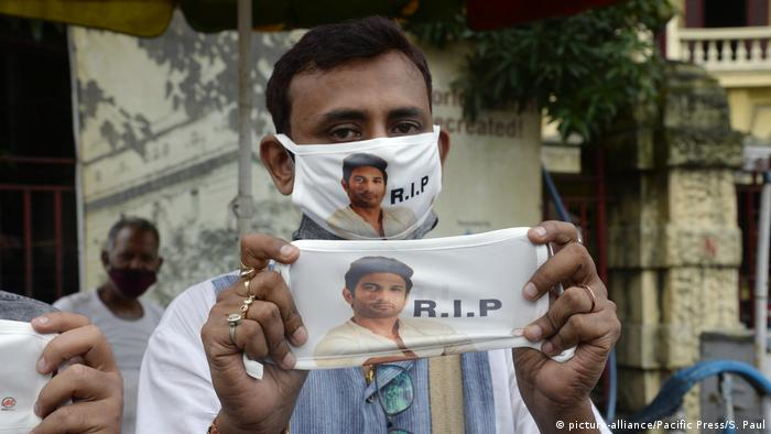 A street vendor sells mask with tribute to late Bollywood actor Sushant Singh Rajput
