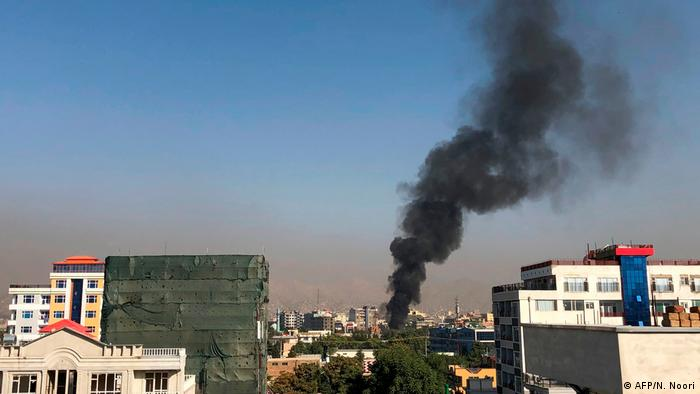 A smoke plume rises following an explosion targeting the convoy of Afghanistan's vice president Amrullah Saleh