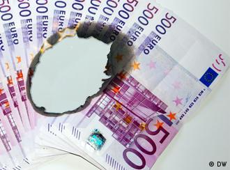 euro bills with a hole