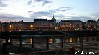 The French city Nantes alongside the Loire River is shown at dusk