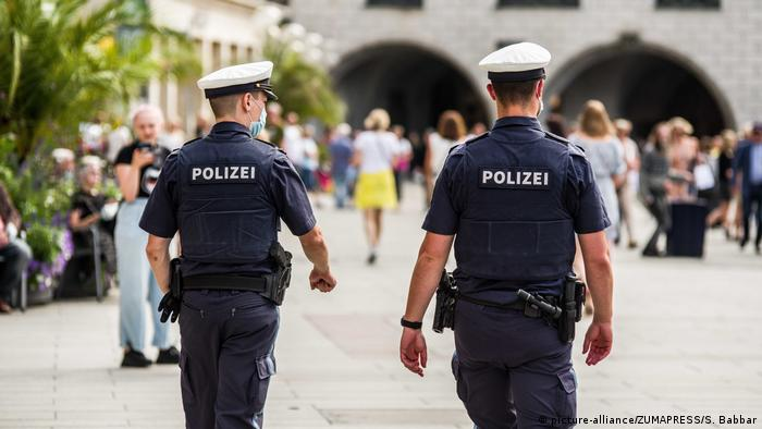 Two officers from the Munich Police patrol Marienplatz for assorted criminality as well as unsafe behavior that can transmit Coronavirus