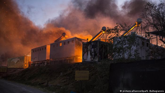Housing units engulfed by flames at the Moria refugee camp on Lesbos