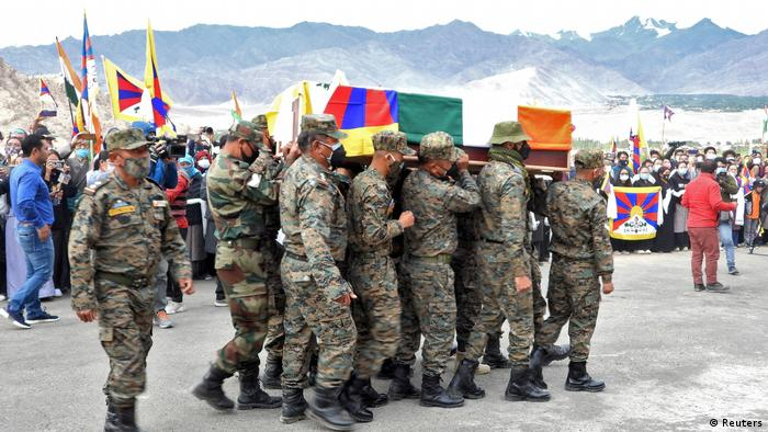 Indian army soldiers carry a coffin with the body of Nyima Tenzin, a Tibetan-Indian soldier
